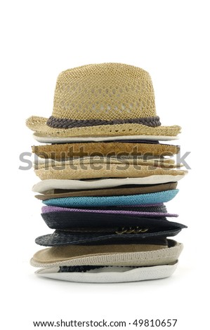 Stacks of straw hats on white - stock photo
