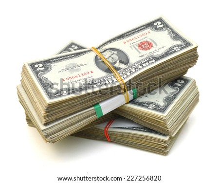 Stacks of two dollars banknotes close-up isolated on white  - stock photo