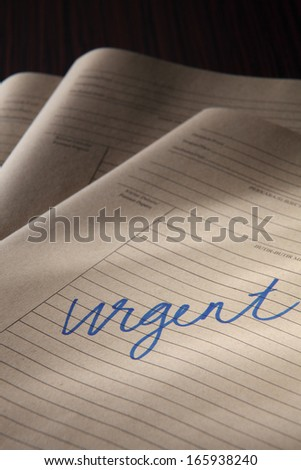 stacks of urgent brown paper files  - stock photo