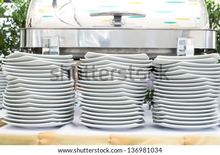 Stacks of white plates for a buffet