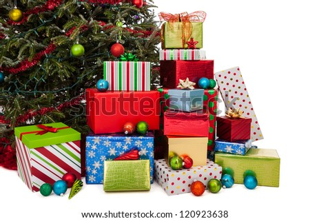 Stacks of wrapped Christmas gifts under the tree isolated on white - stock photo