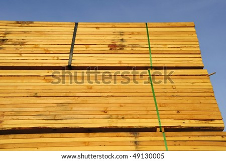 Stacks of 2 x 6 lumber to be used for construction projects