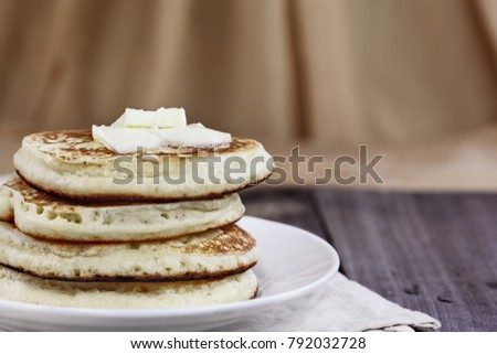 Stacl of homemade pancakes with melting butter. Extreme shallow depth of field. Perfect for Shrove Tuesday.