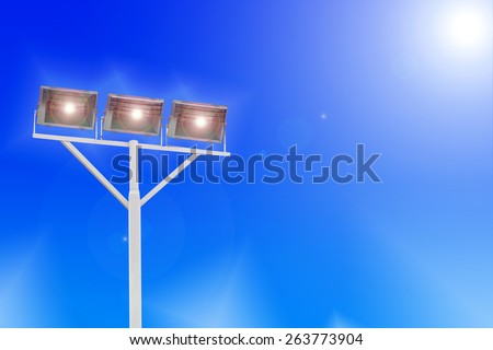 Stadium floodlights on a sports field at night - stock photo