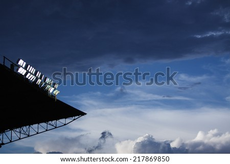 Stadium in lights at sunset - stock photo