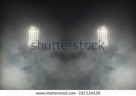 Stadium lights against dark night sky background - stock photo