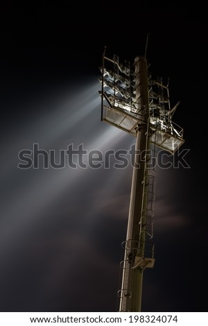 Stadium lights from behind  - stock photo