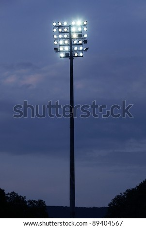 Stadium lights on a sports field at evening - stock photo