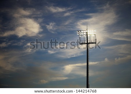 Stadium lights on a sports field at night - stock photo
