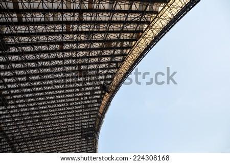 Stadium roof in shadow - stock photo