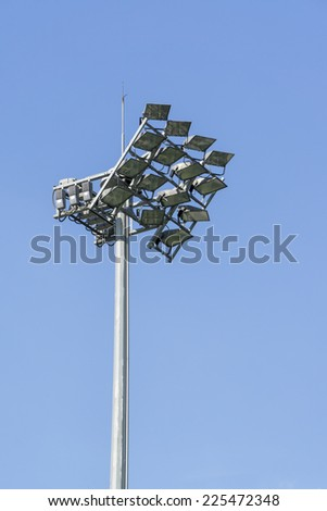 stadium sports lighting against on blue sky background - stock photo