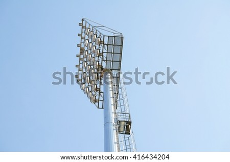 stadium spotlight with blue sky background