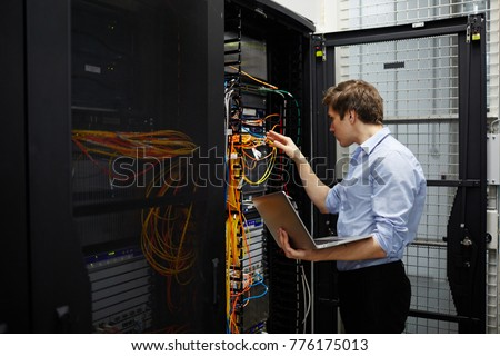 Staff of cryptocurrency hardware service checking system of crypto transaction