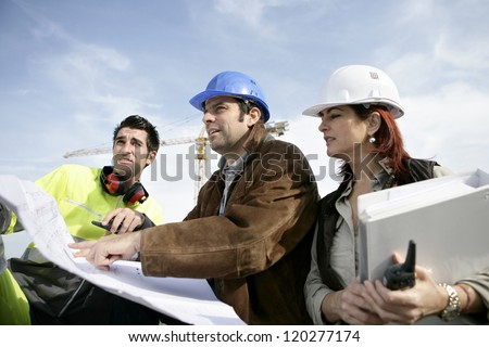 Staff on construction site - stock photo