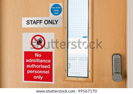 staff only door signs outside laboratory room with security door lock keypad - stock photo