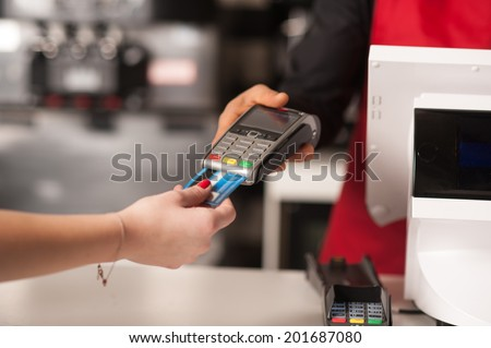 Staff receiving payment by credit card in restaurant - stock photo