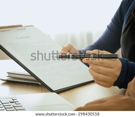 Staff recommended the benefits of insurance coverage and invite customers to sign a contract. - stock photo