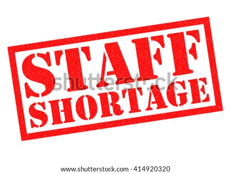 STAFF SHORTAGE red Rubber Stamp over a white background. - stock photo