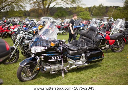 STAFFORD, UNITED KINGDOM - APRIL 27: Visitors Parking Motorcycles  The 34th Carole Nash International Classic MotorCycle Show on April 27, 2014 Stafford United Kingdom