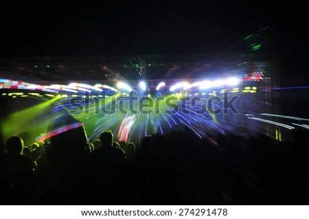 Stage lighting effect in the dark, fuzzy figure   - stock photo