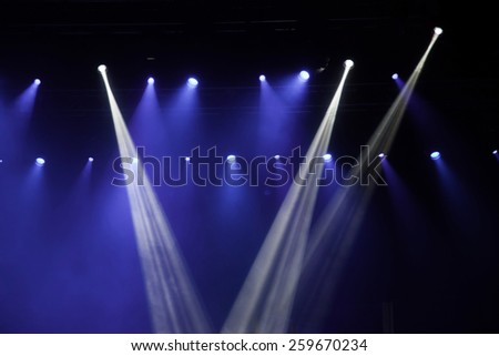 Stage lights on concert. Lighting equipment with multi-colored beams. - stock photo