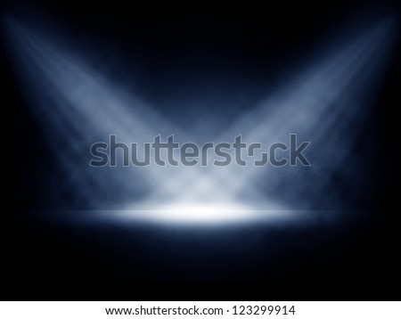 Stage lights with smoky effect background. - stock photo