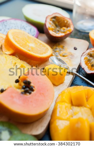 Stage Preparation Fresh Juice Yellow Orange Tropical Fruits Papaya Pine Apple Mango Passion Fruit Dragon Orange  - stock photo