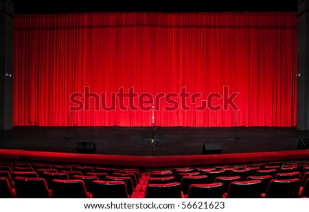 Stage red curtains over wooden floor - stock photo