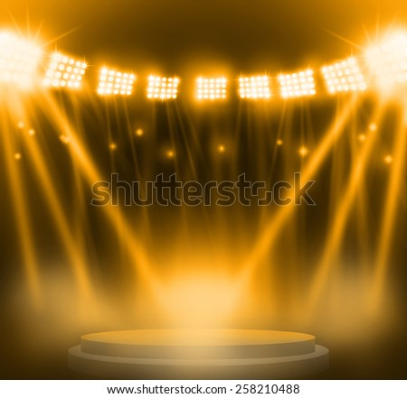 stage spot lighting over yellow background. - stock photo