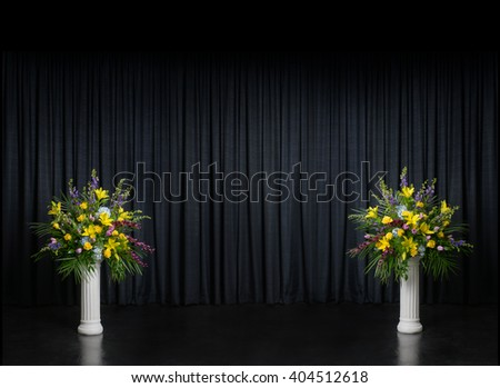 stage with 2 floral pieces on columns - stock photo