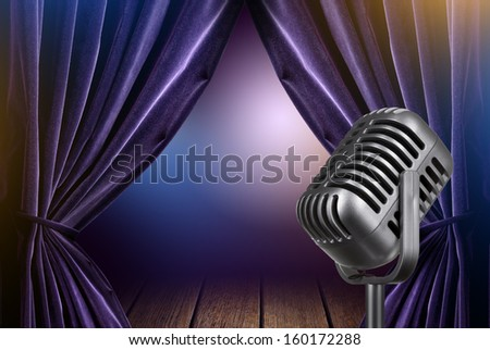 stage with open curtains and microphone - stock photo