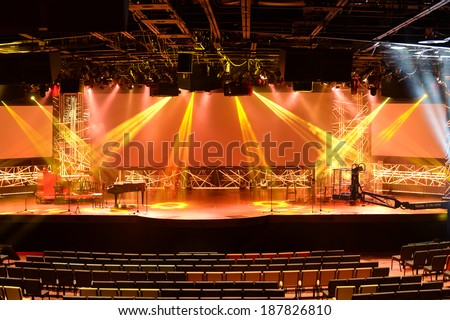 Stage with piano and light beams - stock photo
