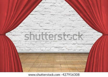 Stage with red curtains, on old brick wall background. - stock photo
