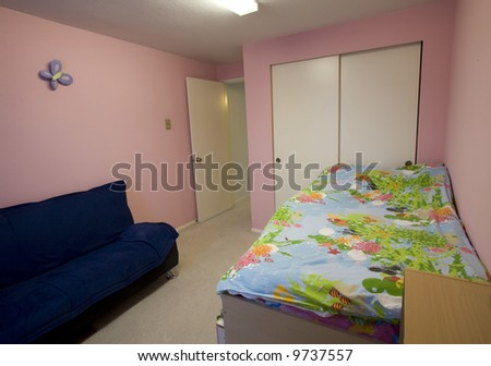 Staged child's bedroom in a condominium for sale - stock photo