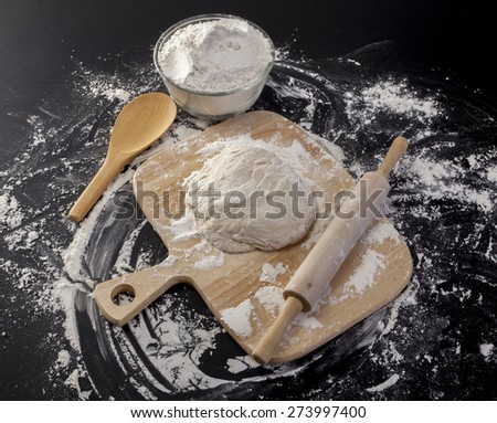 Stages of Making Bread-Flour, Dough and Loaf of Bread on  Black Background - stock photo