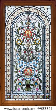stained colorful lead window with floral motif - stock photo