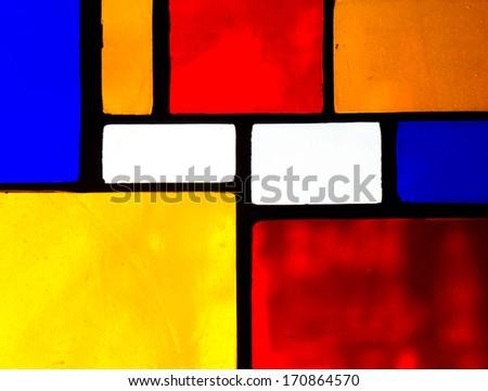 Stained glass church window in a reddish tone - stock photo