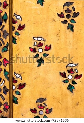 stained glass flower on gold background, Traditional Thai style art on temple. - stock photo