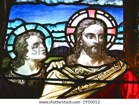 Stained glass pictorial of Jesus and a Disciple.
