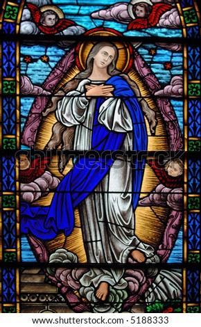 Stained glass representing Immaculate Conception from a 19th century ( built 1875 - 1899) church.