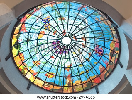 Stained glass roof with sea fish - stock photo