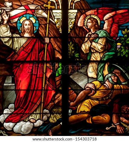 Stained glass window depicting Bible story of Easter resurrection of Jesus Christ - stock photo