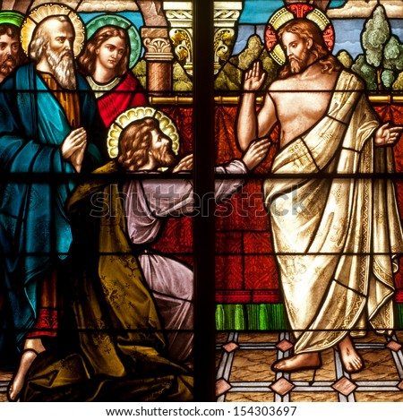 Stained glass window depicting Easter resurrection story of Doubting Thomas