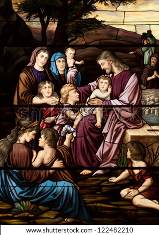 Stained glass window depicting gospel story of Jesus with the children - stock photo