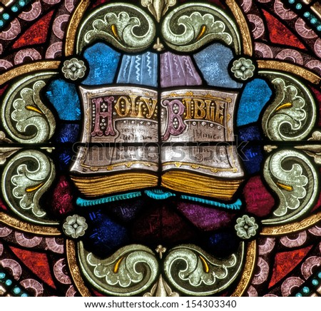 Stained glass window depicting Holy Bible - stock photo