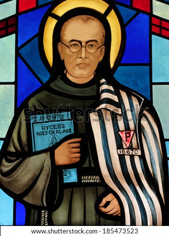 Stained glass window depicting St. Maximilian Kolbe, a Franciscan priest who died in the concentration camp of Auschwitz, Poland; patron saint of drug addicts, political prisoners and journalists
