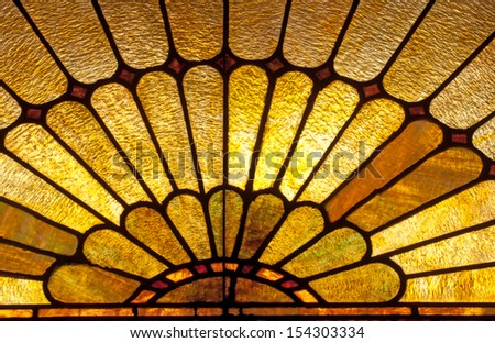 Stained glass window depicting sun burst or sun rays - stock photo