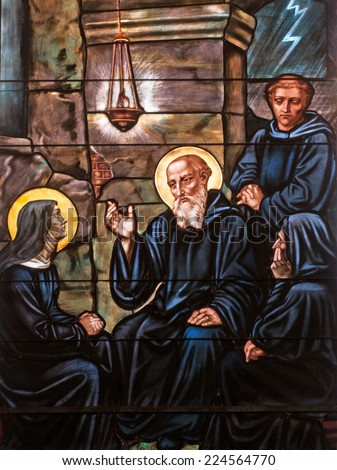 Stained glass window depicting twins St. Benedict and St. Scholastica, founders of Benedictine monasticism - stock photo