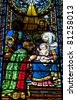 Stained-glass window in Montserrat Monastery (founded in 1025) - stock photo