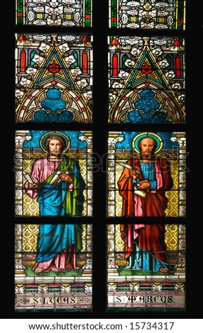 Stained glass window in St.Vitus cathedral, Prague, depicting St. Lucas and St. Marcus.